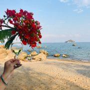 Enjoying a glass of wine on an empty beach at Lake Malawi