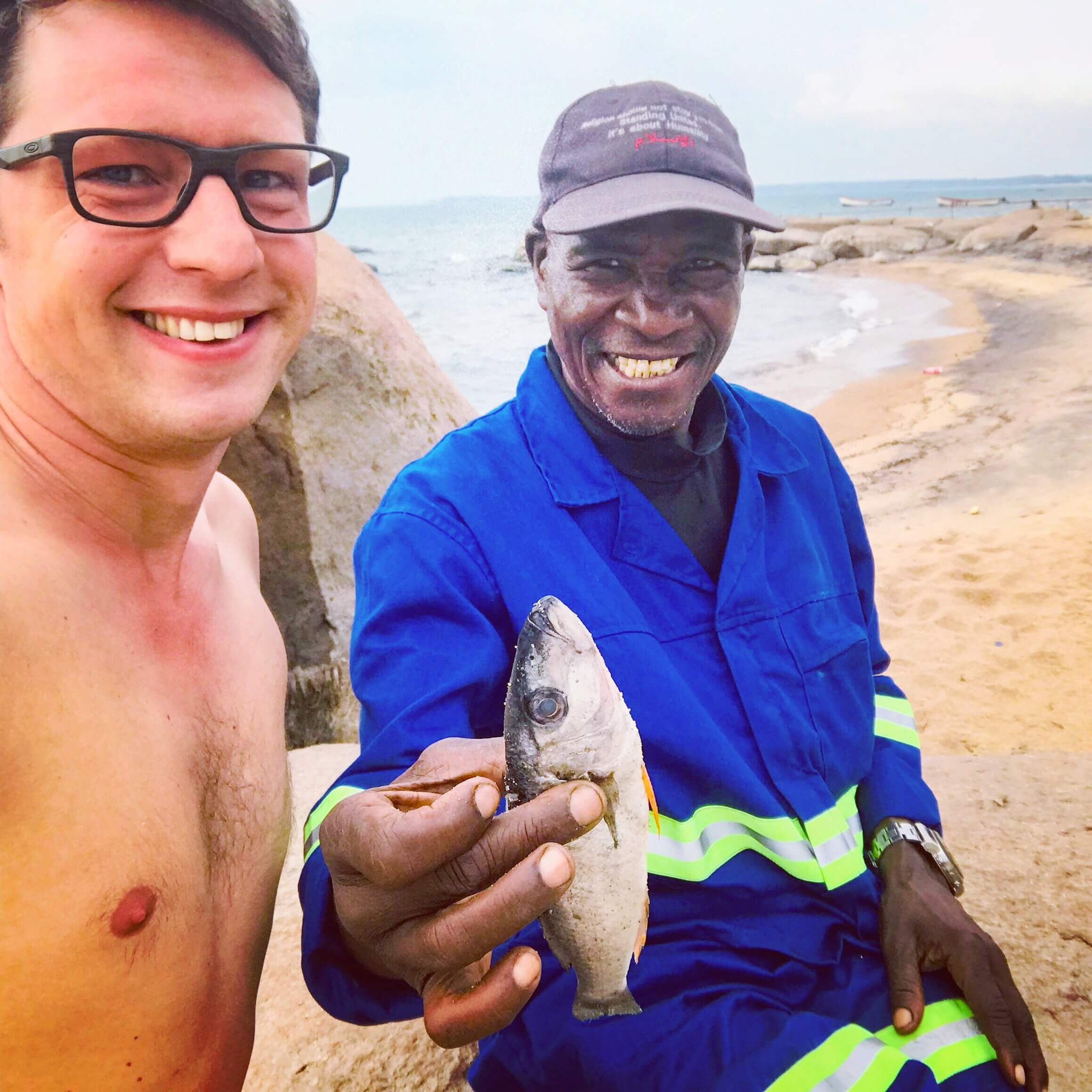 Dilo with a local fisherman at Lake Malawi