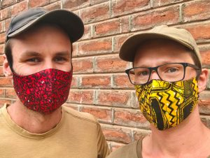 Hessel and Dilo wearing an African-style face mask