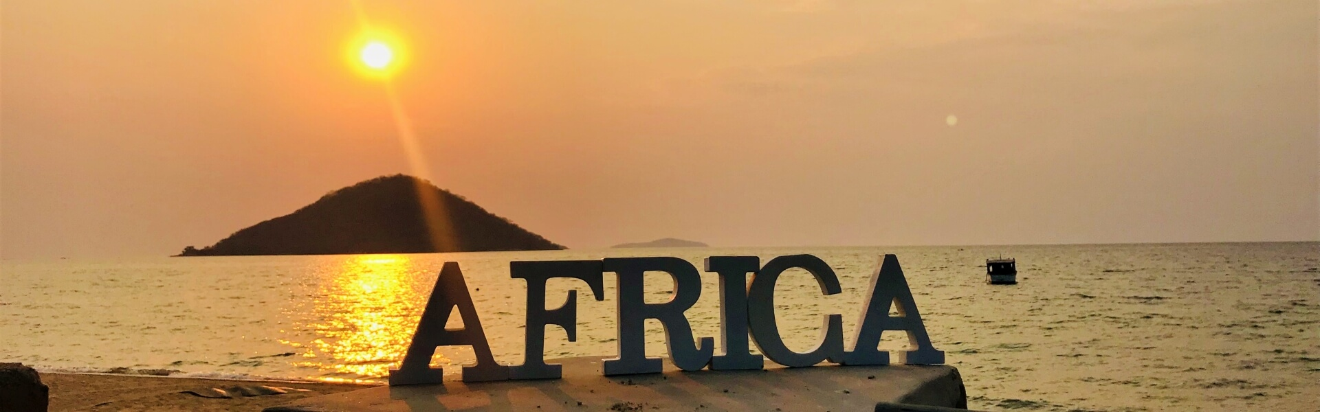 Big letters Africa in front of Lake Malawi