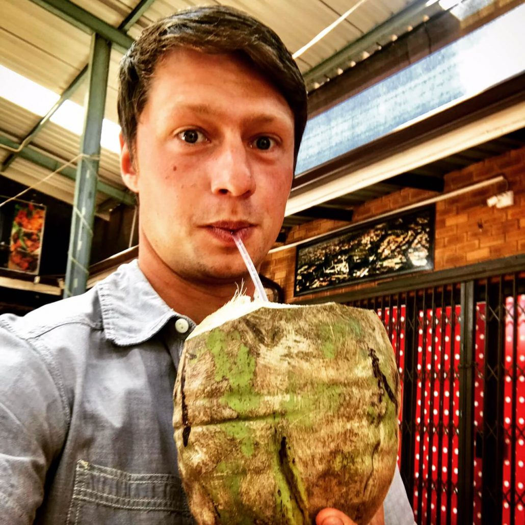 Dilo drinking form a coconut
