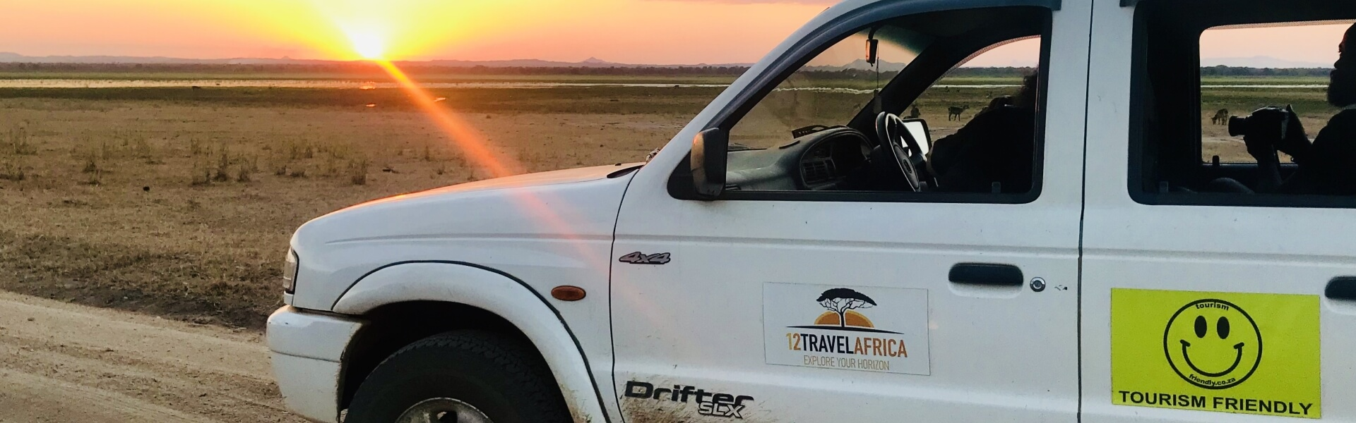 The car of 1 2 Travel Africa at sunset