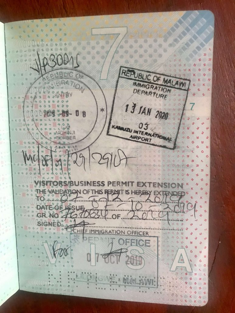 Passport with stamps of visa for Malawi